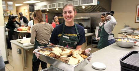 Suffolk University student, Elise Kapitancek volunteers at Rosie's Place.