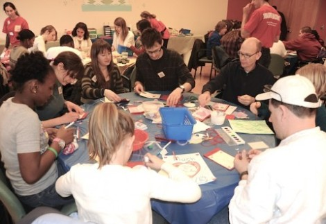 Volunteers at Many Helping Hands' MLK Day of Service make Valentines for senior citizens.