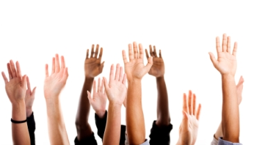 hands raised for volunteering